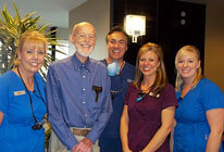 five dental professionals smiling