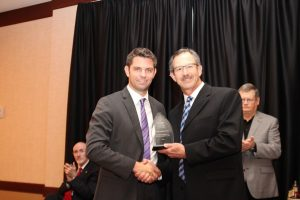 Dr. Jay Davidson presented Dr. Jacob Krehbiel with an outstanding volunteer award.