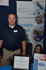 Matt Parker, CDT accepts award on behalf of Burdette Dental Lab in AL