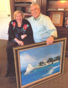 Myrtle and Dr. Ken Friday with patient's artwork